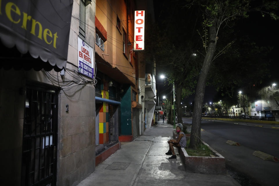 Homeless sex worker Angora, 26, waits outside a hotel as she tries to earn money after having her bag stolen by a man pretending to be a client, in Mexico City, Thursday, March 25, 2021. Rules of the partial lockdown due to the coronavirus pandemic forced many hotels to close, and others raised the prices they charge sex workers. That left some earning only three or four dollars from each client. (AP Photo/Rebecca Blackwell)