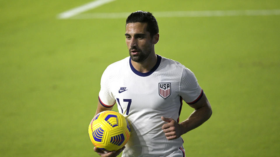 United States midfielder Sebastian Lletget (17) sets up for a corner kick during the first half of an international friendly soccer match against Trinidad and Tobago, Sunday, Jan. 31, 2021, in Orlando, Fla. (AP Photo/Phelan M. Ebenhack)