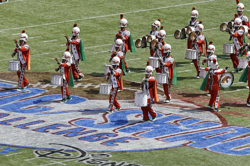 The Florida A&M University band performs at half time Sunday, Sept. 1, 2013, in Orlando, Fla., during FAMU's season-opening football game against Mississippi Valley State, its first appearance in a football stadium in nearly 22 months after the 2011 hazing death of a drum major. All band performances were halted for FAMU's famed Marching 100 shortly after Robert Champion collapsed and died following a hazing ritual on a bus parked at an Orlando hotel in November 2011. (AP Photo/John Raoux)