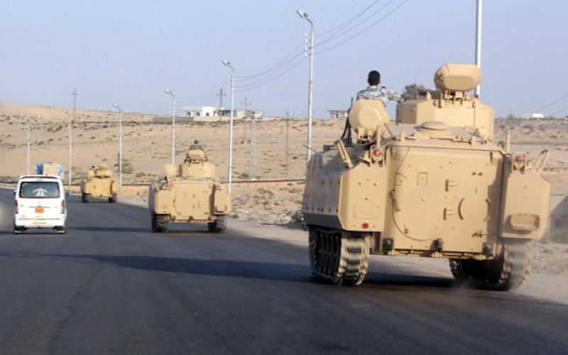 A convoy of Egyptian armoured vehicles heads along a road in El-Arish on the Sinai Peninsula on August 13, 2011