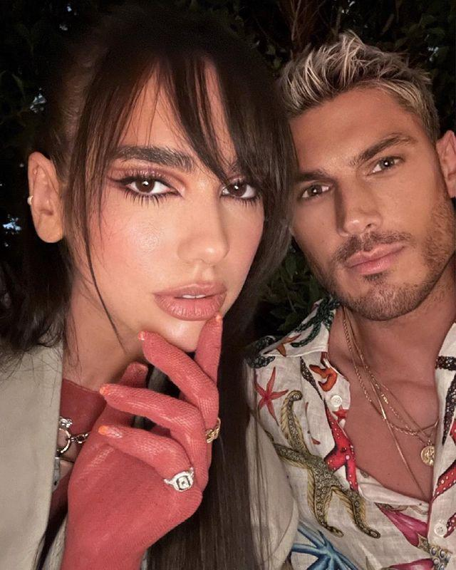 """<p>Dua Lipa gave her go-to super long brown hair a 2021 update with a new wispy fringe courtesy of friend and A-list hairstylist Chris Appleton. The Brit award winner completed her new look with contoured cut crease eye make-up and sheer red gloves. As Appleton put it in his Instagram caption, 'Bang Bang'.</p><p><a href=""""https://www.instagram.com/p/CQUfHBWBBBe/?utm_source=ig_embed&utm_campaign=loading"""" rel=""""nofollow noopener"""" target=""""_blank"""" data-ylk=""""slk:See the original post on Instagram"""" class=""""link rapid-noclick-resp"""">See the original post on Instagram</a></p>"""