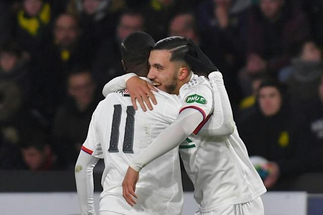 Rayan Cherki (R) is embraced by one of his Lyon teammates during his sparkling performance in a French Cup win over Nantes (AFP Photo/LOIC VENANCE)