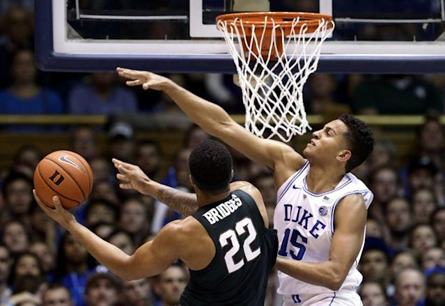Duke's Frank Jackson defends Michigan State's Miles Bridges. (AP)