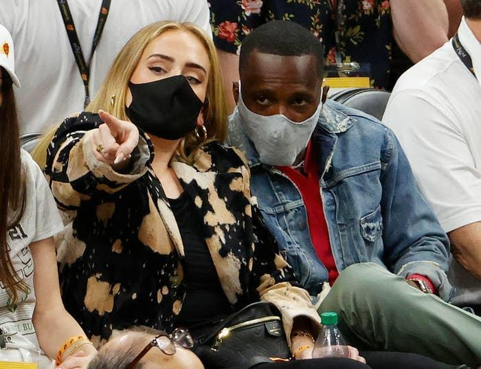 Adele looks on next to Rich Paul during the first half in Game Five of the NBA Finals between the Milwaukee Bucks and the Phoenix Suns
