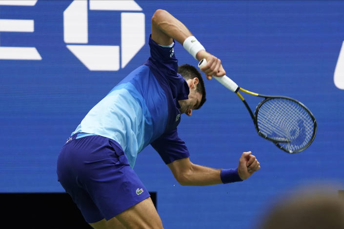 Novak Djokovic, of Serbia, smashes his racket after losing a point to Daniil Medvedev, of Russia, during the men's singles final of the US Open tennis championships, Sunday, Sept. 12, 2021, in New York. (AP Photo/John Minchillo)