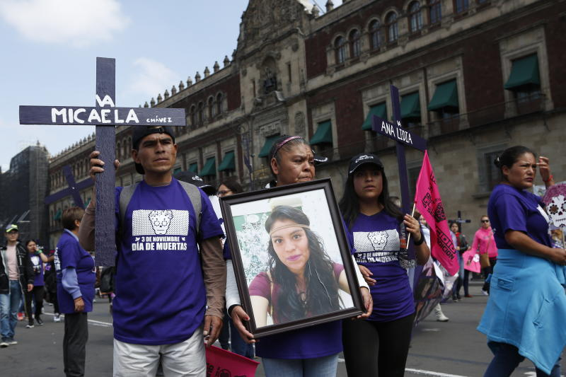 Virginia Elizalde carries a portrait of her daughter Micaela Chavez, who disappeared on Feb. 4, 2017, during a protest demanding justice for women who have been murdered or disappeared, one day after the Day of the Dead holiday in Mexico City, Sunday, Nov. 3, 2019. Nine women are killed per day in Mexico, according to the U.N. (AP Photo/Ginnette Riquelme)