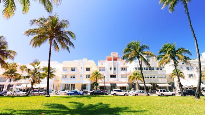 Art Deco buildings and palm trees on Ocean Drive in Miami Beach.