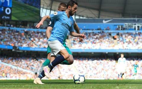 Bernardo Silva of Manchester City runs with the ball during the Premier League match between Manchester City and Tottenham Hotspur - Credit: GETTY IMAGES