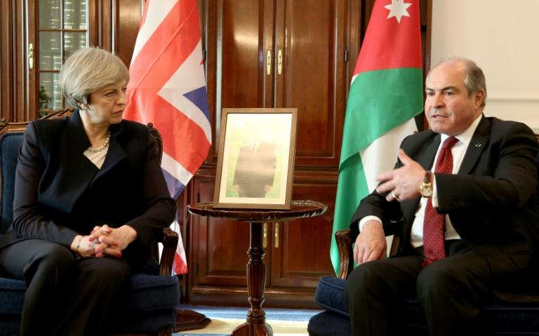 British Prime Minister Theresa May meets Jordanian Prime Minister Hani Mulqi in Amman on April 3, 2017