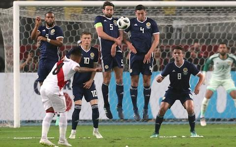"A makeshift and inexperienced Scotland side were beaten 2-0 by World Cup-bound Peru at the frenzied Estadio Nacional in Lima. It was all going pretty well for Alex McLeish's men until the 37th minute when Christian Cueva scored from the spot after defender Scott McKenna had handled in the penalty area. Lokomotiv Moscow's Jefferson Farfan made it 2-0 from close range in the 47th minute with Millwall keeper Jordan Archer, one of four starting debutants, looking culpable again after his misjudgement had led to the earlier penalty. Peru are on the way to the World Cup for the first time in 36 years and in front of 40,000 exuberant home fans Ricardo Gareca's side, ranked 11th in the world, threatened to impose more damage. However, the Scots steadied themselves and looked solid enough while ending the night with seven new faces having made their first appearances for the national team. McLeish said: ""The first goal was a big set-back. I felt we contained Peru very well, they are a good team, technically good, very strong, quick. ""It was very disappointing to lose the goal at the moment we lost it, just before half-time. ""It was really a basic ball over the top and normally it should be easy for the defender, but we didn't deal with it well. But overall I was happy with the team's display. Scotland fielded seven debutants during the match in Lima Credit: reuters ""I thought the defenders were very strong, very organised, didn't make it easy for Peru. The second half, after the early goal, it gave them some more confidence to show their skills and at that moment in the game it was a bit difficult. ""We got over it and made a couple of chances in the end, but never really threatened the goal. But maybe if we did other things we could maybe have had a goal out of the game."" It was always going to be difficult for McLeish to shape up a team capable of giving the South Americans a real test. After six call-offs to a squad which was already without a clutch of regulars, the former Scotland defender had nine uncapped players, including all three keepers, with Archer selected for the first time. Kilmarnock right-back Stephen O'Donnell and Hibernian duo, Lewis Stevenson and Dylan McGeouch, were included in a side captained by Blackburn Rovers skipper Charlie Mulgrew who, in winning his 35th cap, was the most experienced player in the team. The Incas, on an unprecedented 12-game unbeaten run, were missing their captain Paolo Guerrero to a 14-month drug ban but had the influential Farfan leading the line. Peru are preparing for the World Cup in Russia Credit: reuters Archer started the game strongly, diving low to his right within minutes to make a decent save from Cueva's 25-yard free-kick. However, the Scots played their way into the game, growing in confidence with each passing minute. Archer, though, was tested again in the 32nd minute, this time by a Farfan drive from outside the box. But when the Lokomotiv striker's curling shot at goal was blocked by the hand of McKenna, after the Scotland keeper had rushed out to the edge of the box to collide with Mulgrew, Mexican referee Fernando Guerrero pointed to the spot. Cueva fired his penalty low and hard into the corner of the net and suddenly the home side raised their game with Archer spilling a powerful drive from Andre Carrillo, with the Scots surviving. However, two minutes after the restart Archer again did not look too clever as Farfan's 12-yard drive from a Edison Flores cut-back went under his body. In the 63rd minute Oliver McBurnie and Callum Paterson replaced Jamie Murphy and John McGinn before Celtic new boy Lewis Morgan replaced Matt Phillips to makes his debut and there was a tinkering of formation. Paterson almost found McBurnie with a good ball to the back post, a move that encouraged the few hundred Tartan Army inside the ground who saw Graeme Shinnie replace McGeouch in the 76th minute to make his debut. McLeish ext takes his inexperienced team to face Mexico at the Azteca stadium on June 2."