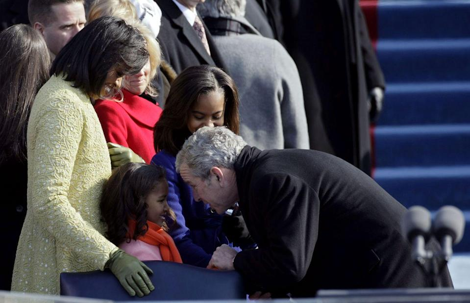 <p>President George W. Bush greets Sasha Obama at the inauguration of Barack Obama as the 44th President of the United States of America on January 20, 2009 in Washington, DC.</p>
