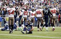 Seattle Seahawks wide receiver Golden Tate (81) sits on the turf after Tampa Bay Buccaneers defensive back Keith Tandy intercepted a pass in the second half of an NFL football game, Sunday, Nov. 3, 2013, in Seattle. (AP Photo/Elaine Thompson)