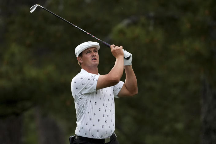 Bryson DeChambeau watches his shot on the 17th hole during the first round of the Masters golf tournament on Thursday, April 8, 2021, in Augusta, Ga. (AP Photo/Charlie Riedel)
