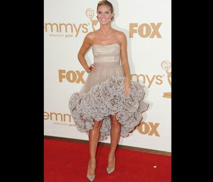"Photo by: Jordan Strauss/WireImage<br />Heidi Klum-<br />At a ceremony where most attendees go all out in floor-length haute couture, Project Runway host Heidi Klum dared to bare her legs in a custom Christian Siriano frock with an asymmetrical hem. What's her secret to an uber-toned lower body? According to her trainer (and Klum's Twitter!), the supermodel swears by walking lunges. <br> <br> <b>Heidi's Training Plan:</b> Her trainer David Kirsch told SELF she's been running four miles at a time in the summer to reach her goal of running daily. She says, ""I don't love running, but I do like to see everything getting tighter and toned."" <br> <br> <b><a rel=""nofollow"" href=""http://www.self.com/fitness/workouts/2011/10/crossfit-slideshow?mbid=synd_yshine"">Try SELF's exclusive total-body CrossFit workouts.</a></b> <br> <br> <b>More from Self: <br> <br> • <a rel=""nofollow"" href=""%20http://www.self.com/healthystars/2011/05/gwyneth-paltrows-arm-and-ab-moves-slideshow?mbid=synd_yshine"">Gwyneth Paltrow's Arm and Ab Moves</a> <br> • <a rel=""nofollow"" href=""%20http://www.self.com/fitness/workouts/2010/06/yoga-for-abs-workout-slideshow?mbid=synd_yshine"">Yoga Moves for Flat Abs</a> <br> • <a rel=""nofollow"" href=""%20http://www.self.com/fooddiet/2010/03/20-superfoods-slideshow?mbid=synd_yshine#slide=1"">20 Superfoods for Weight Loss</a> <br> • <a rel=""nofollow"" href=""%20http://www.self.com/fooddiet/2011/06/12-ways-to-think-slim-slideshow?mbid=synd_yshine#slide=1"">12 Ways to Think Yourself Slim <br></a></b>"