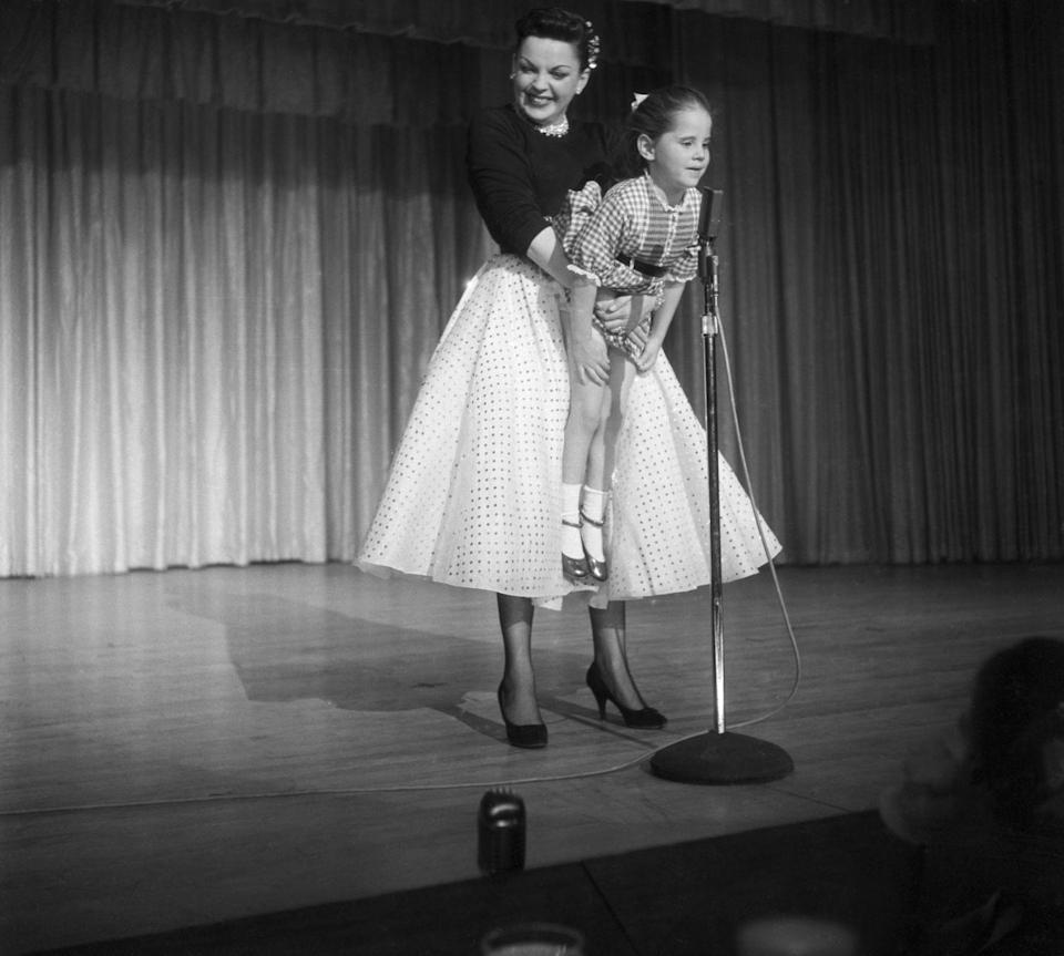 "<p>During a performance in 1957, Judy treats the audience to her daughter's rendition of ""Jingle Bells."" The singer-actress made sure her daughter was the perfect height for the mic. </p>"