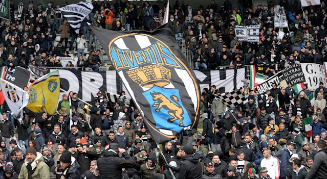 Soccer Football - Serie A - Torino vs Juventus - Stadio Olimpico Grande Torino, Turin, Italy - February 18, 2018 Juventus fans wave flags and display banners before the match REUTERS/Massimo Pinca