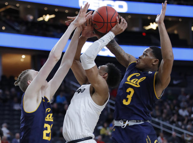 California's Connor Vanover, left, and Paris Austin guard Colorado's Tyler Bey during the first half of an NCAA college basketball game in the first round of the Pac-12 men's tournament Wednesday, March 13, 2019, in Las Vegas. (AP Photo/John Locher)