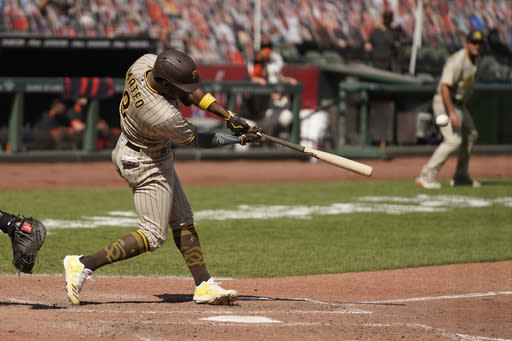 San Diego Padres' Jorge Mateo hits an RBI-double to deep left field off San Francisco Giants relief pitcher Jarlin Garca in the seventh inning of a baseball game Sunday, Sept. 27, 2020, in San Francisco. (AP Photo/Eric Risberg)