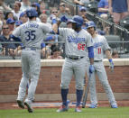 Los Angeles Dodgers' Cody Bellinger, left, celebrates his home run with Yasiel Puig during the fourth inning of a baseball game against the New York Mets at Citi Field, Sunday, June 24, 2018, in New York. (AP Photo/Seth Wenig)