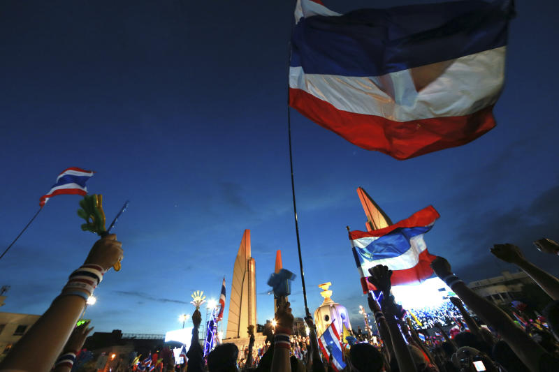 Thai national flags fly at Democracy Monument during an anti-government rally, calling for Thai Prime Minister Yingluck Shinawatra to step down, in Bangkok, Thailand, Sunday, Nov. 24, 2013. Tens of thousands of anti-government demonstrators have taken to the streets of Thailand's capital to protest what they say is ousted Prime Minister Thaksin Shinawatra's influence on the current government. (AP Photo/Wason Wanitchakorn)