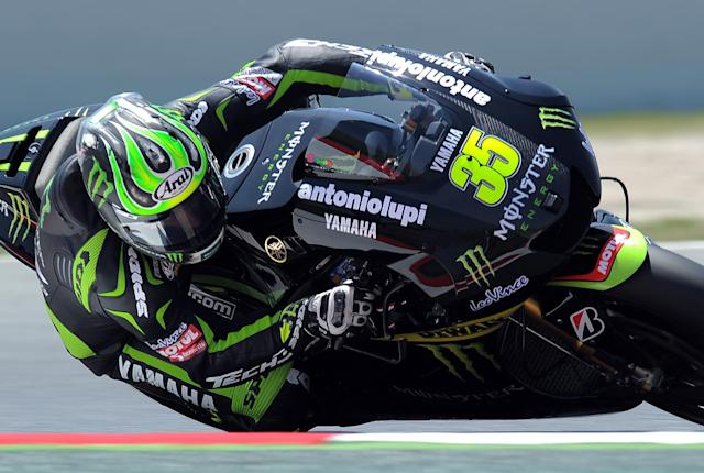Monster Yamaha Tech 3 British Cal Crutchlow takes a curve at the Catalunya racetrack in Montmelo, near Barcelona, on June 1, 2012, during the MotoGP second training session the Catalunya Moto GP Grand Prix. AFP PHOTO / LLUIS GENELLUIS GENE/AFP/GettyImages