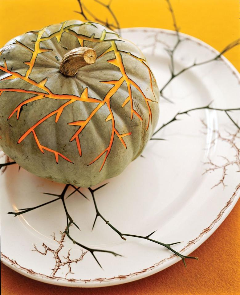 """<p>When you've got themed dishes to match, a spiky jack-o'-lantern can make a great centerpiece or party platter accent. <span></span>Get the tutorial at <a href=""""http://www.countryliving.com/diy-crafts/g1350/pumpkin-decorating-1009/"""" target=""""_blank"""">Country Living</a>.</p>"""