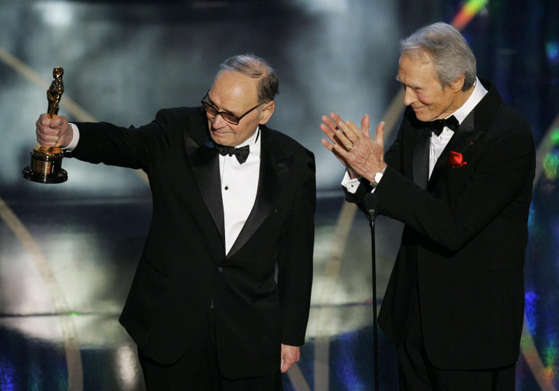 ** EMBARGOED AT THE REQUEST OF THE ACADEMY OF MOTION PICTURE ARTS AND SCIENCES FOR USE UPON CONCLUSION OF THE ACADEMY AWARDS TELECAST ** Italian composer Ennio Morricone, left, accepts an honorary Oscar for his contributions to the art of film music from presenter Clint Eastwood during the 79th Academy Awards telecast Sunday, Feb. 25, 2007, in Los Angeles. (AP Photo/Mark J. Terrill)