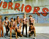 """<p>The cast of The Warriors strike a pose while filming on the boardwalk in Coney Island. Apparently, the warriors sign was <a href=""""https://www.imdb.com/title/tt0080120/trivia"""" rel=""""nofollow noopener"""" target=""""_blank"""" data-ylk=""""slk:painted over a gang's tag"""" class=""""link rapid-noclick-resp"""">painted over a gang's tag</a>, which upset the gang—so producers paid the members to be in the film.</p>"""