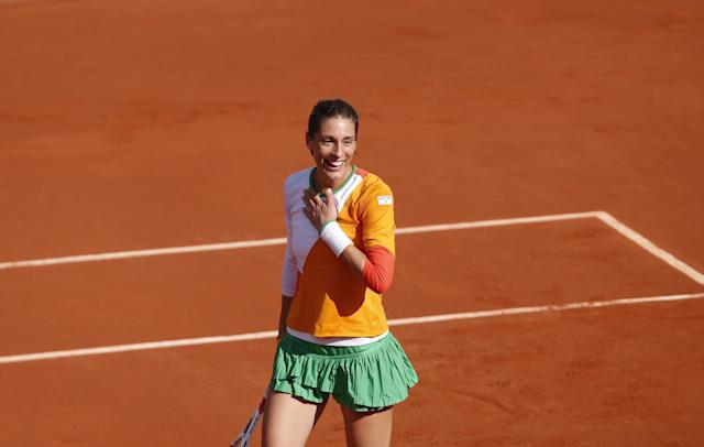 Germany's Andrea Petkovic reacts after defeating Italy's Sara Errani during their quarterfinal match of the French Open tennis tournament at the Roland Garros stadium, in Paris, France, Wednesday, June 4, 2014. Petkovic won 6-2, 6-2. (AP Photo/Darko Vojinovic)