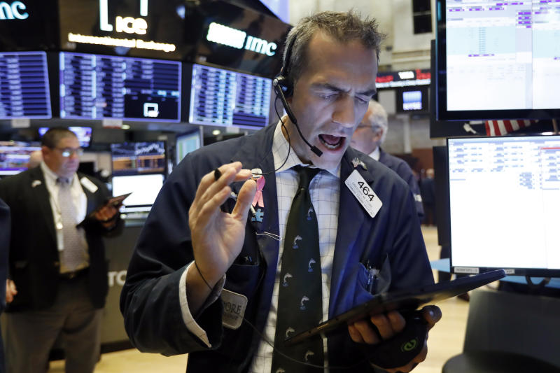 Trader Gregory Rowe works on the floor of the New York Stock Exchange, Wednesday, Sept. 4, 2019. Stocks are opening higher on Wall Street following big gains in Asia as Hong Kong's government withdrew a controversial extradition law that set off three months of protests there. (AP Photo/Richard Drew)