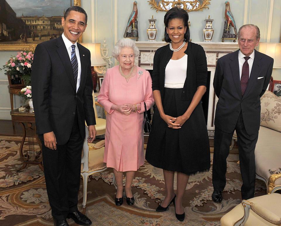 U.S. President Barack Obama (L) and his wife Michelle (2nd R) pose for a photograph with Britain's Queen Elizabeth and Prince Philip, the Duke of Edinburgh, at Buckingham Palace in London April 1, 2009. Obama said on Wednesday there was