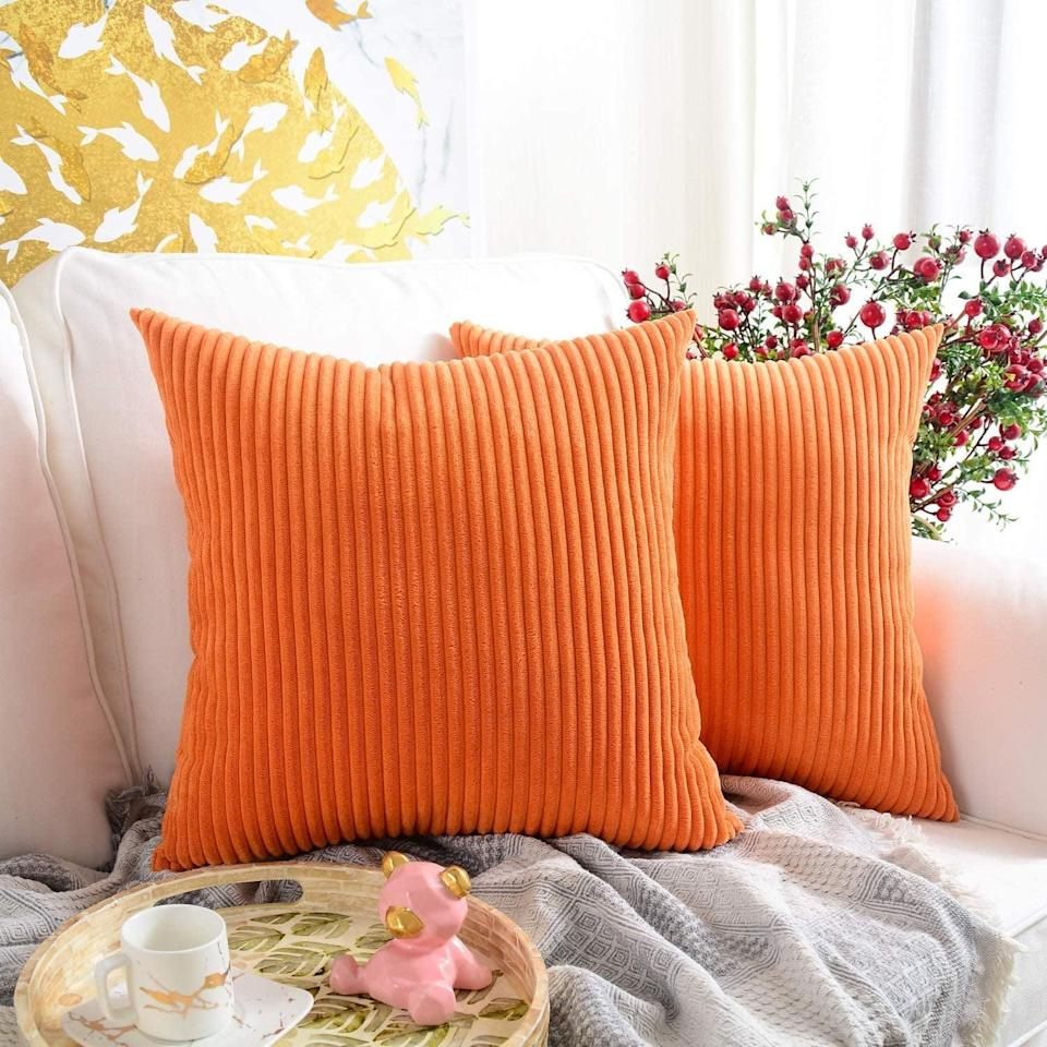 <p>This <span>Mernette Square Throw Pillow (Set of 2)</span> ($13) will make your couch that much more glam.</p>