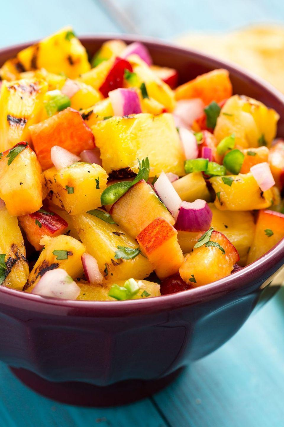 "<p>This smoky-sweet salsa will ruin you for all other dips. </p><p>Get the <a href=""https://www.delish.com/uk/cooking/recipes/a33008202/grilled-pineapple-salsa-recipe/"" rel=""nofollow noopener"" target=""_blank"" data-ylk=""slk:Grilled Pineapple Salsa"" class=""link rapid-noclick-resp"">Grilled Pineapple Salsa</a> recipe.</p>"