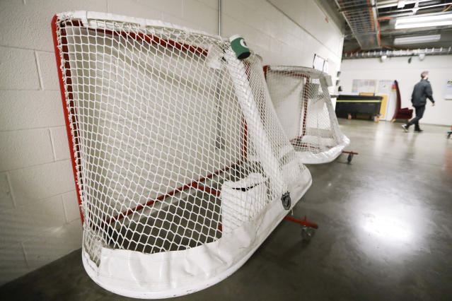 Goals used by the NHL hockey club Nashville Predators are stored in a hallway in Bridgestone Arena, Thursday, March 12, 2020, in Nashville, Tenn. The NHL announced Thursday it is suspending its season indefinitely in response to the coronavirus. (AP Photo/Mark Humphrey)