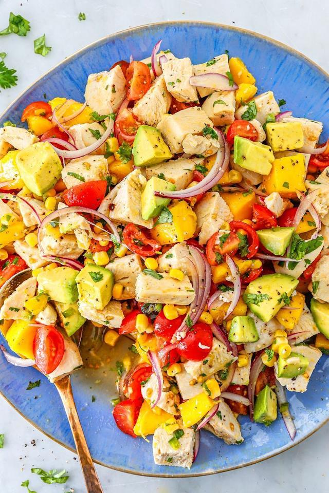 """<p>We love this salad served on top of greens as much as we love it between two slices of <a href=""""https://www.delish.com/uk/cooking/recipes/a31328594/how-to-make-sourdough-bread-recipe/"""">Sourdough Bread</a>. If you can't find a good ripe mango, pineapple would be delicious as well! </p><p>Get the <a href=""""https://www.delish.com/uk/cooking/recipes/a33641941/avocado-chicken-salad-recipe/"""" target=""""_blank"""">Avocado Chicken Salad</a> recipe.</p>"""