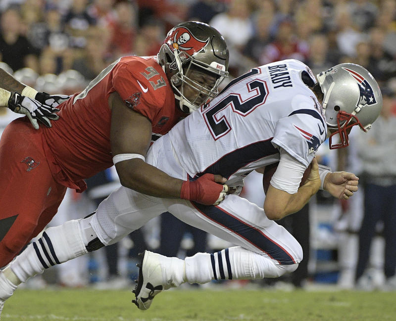 Tampa Bay Buccaneers defensive tackle Gerald McCoy (93) sacks New England Patriots quarterback Tom Brady (12) during Thursday night's game. (AP)