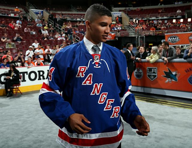 Daniel Walcott meets his team after being drafted #140 by the New York Rangers on Day Two of the 2014 NHL Draft.