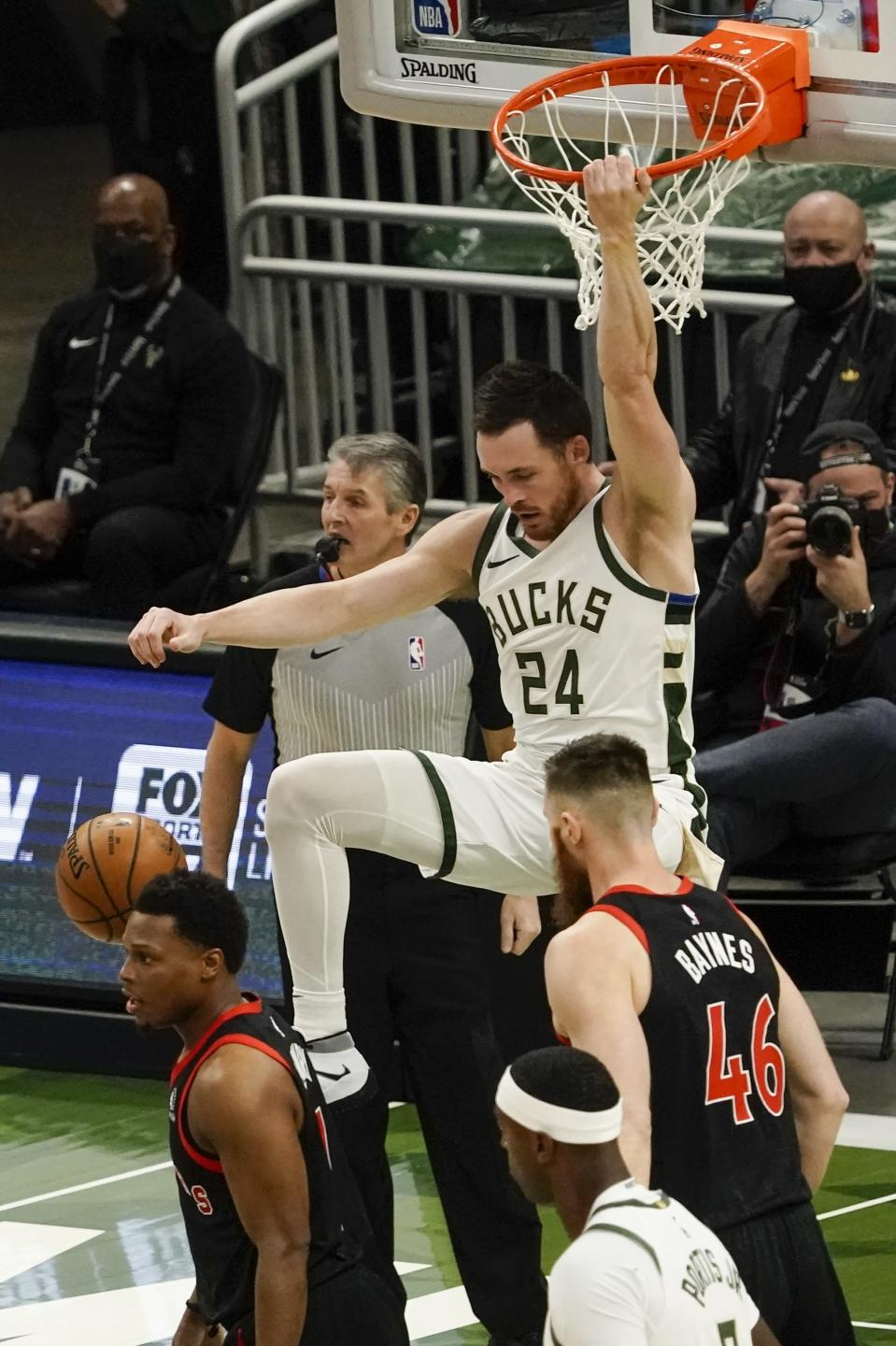Milwaukee Bucks' Pat Connaughton dunks during the first half of an NBA basketball game against the Toronto Raptors Tuesday, Feb. 16, 2021, in Milwaukee. (AP Photo/Morry Gash)