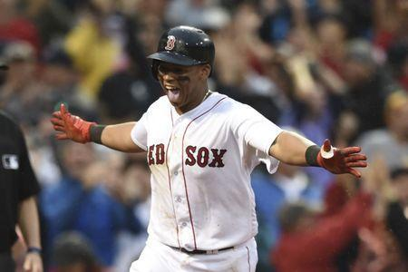 Oct 9, 2017; Boston, MA, USA; Boston Red Sox third baseman Rafael Devers (11) celebrates his inside-the-park home run against the Houston Astros during the ninth inning in game four of the 2017 ALDS playoff baseball series at Fenway Park. Mandatory Credit: Bob DeChiara-USA TODAY Sports