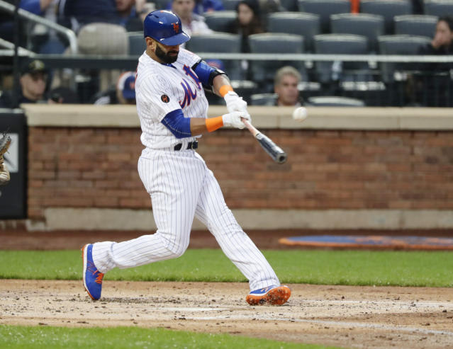New York Mets' Jose Bautista (11) hits a double during the second inning of a baseball game against the Miami Marlins Tuesday, May 22, 2018, in New York. (AP Photo/Frank Franklin II)