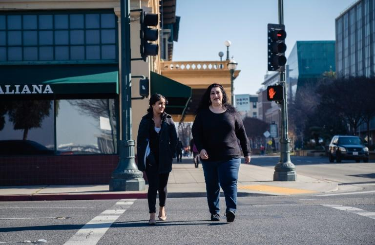 Lorrine Paradela, right, a 45-year-old single mother is one Stockton resident receiving monthly cash as a 'universal basic income'