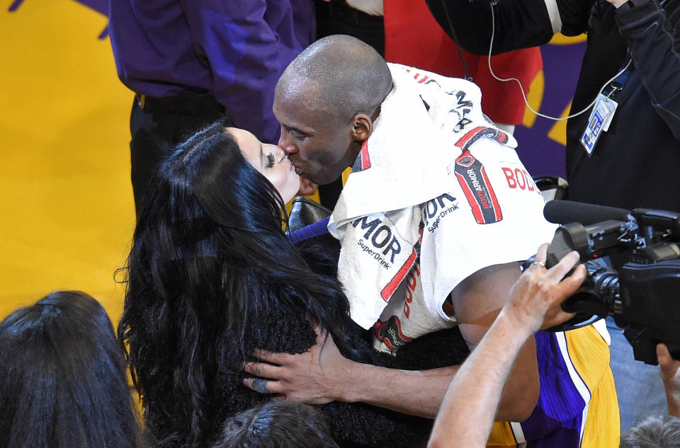 Los Angeles Lakers forward Kobe Bryant kisses his wife, Vanessa, after an NBA basketball game against the Utah Jazz, Wednesday, April 13, 2016, in Los Angeles. Bryant scored 60 points in what he said is his final NBA game as the Lakers won 101-96. (AP Photo/Mark J. Terrill)
