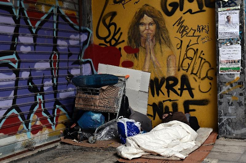 """Greece has responded sharply to apparent pressure from the EU not to pass Wednesday a """"humanitarian crisis"""" law that would provide free electricity and food stamps for the poorest households (AFP Photo/Louisa Gouliamaki)"""
