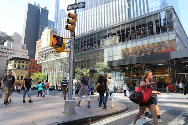 <p>People on the move across from Four World Trade Center and its shopping centers on Church Street on Sept. 4, 2017. (Photo: Gordon Donovan/Yahoo News) </p>