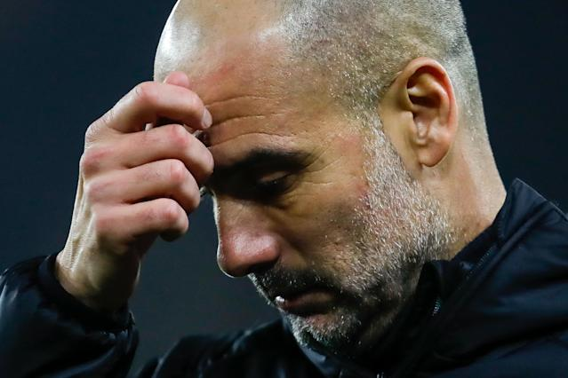 Guardiola scratches his head at Molineux (Photo by James Baylis - AMA/Getty Images)