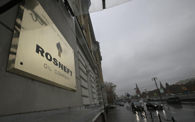 FILE - In this Oct. 18, 2012 file photo, a plaque of Rosneft is seen outside its headquarters in Moscow, Russia. British oil company BP says it has agreed to sell its stake in its TNK-BP joint venture to Russian oil company Rosneft for US$17.1 billion in cash and a 12.84 percent stake in Rosneft. BP announced Monday, Oct. 22, 2012, that it would use some of the money to buy more shares in Rosneft to raise its stake to 19.75 percent. (AP Photo/Mikhail Metzel)