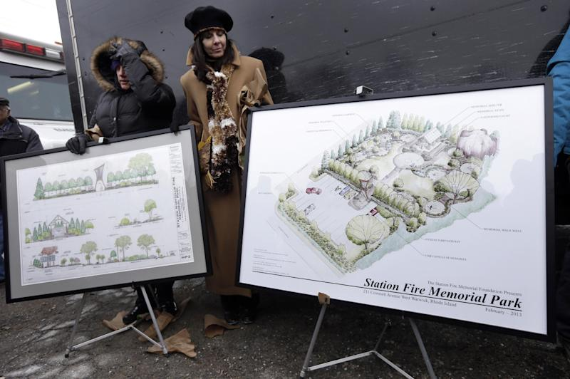 File -- In this Sunday, Feb. 17, 2013 file photo Diane Gomes, of Johnston, R.I., left, and Elaine Grant, of Lincoln, R.I., center, display artist's renderings of a planned permanent memorial for victims of The Station nightclub fire, a blaze that claimed the lives of 100 people, during ceremonies at the site of the fire, in West Warwick, R.I. The Station Fire Memorial Foundation, which is working to build a memorial at the site of a nightclub fire, is having trouble raising money for the project which is already underway. The project is estimated to cost $1.4 million and they have less than $200,000 in the bank. (AP Photo/Steven Senne, File)