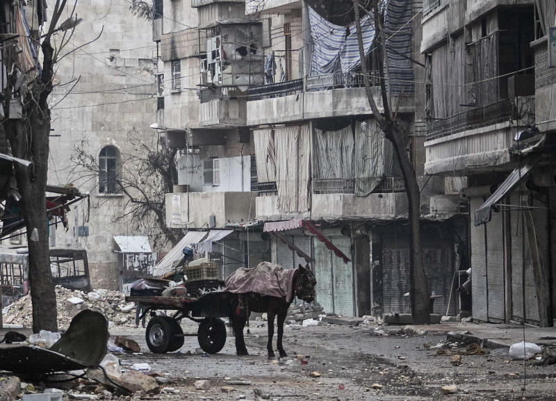 This Monday, Dec. 17, 2012 photo, shows damaged buildings due to heavy clashes between Free Syrian Army fighters and government forces in the Karmal Jabl neighborhood in Aleppo, Syria. (AP Photo/Narciso Contreras)