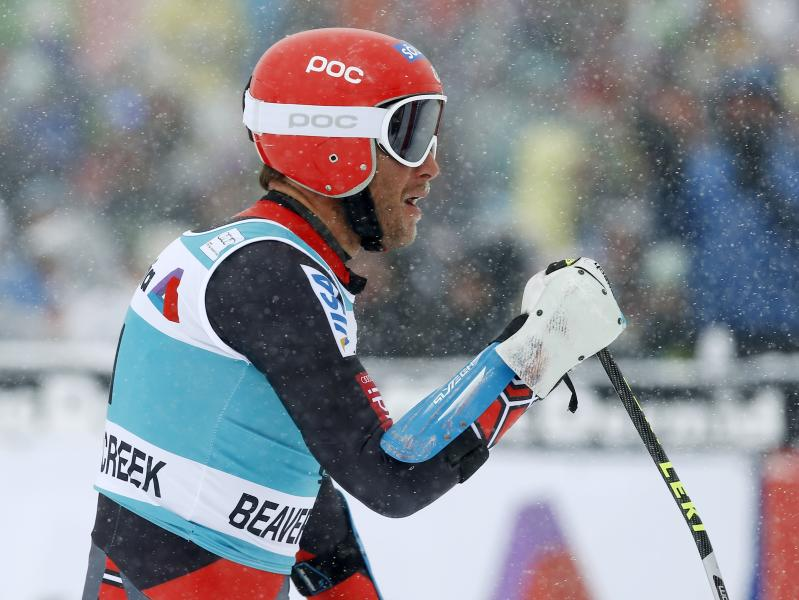 Bode Miller pumps his fist after finishing his first run during the men's World Cup giant slalom skiing event, Sunday, Dec. 8, 2013, in Beaver Creek, Colo.(AP Photo/Julie Jacobson)