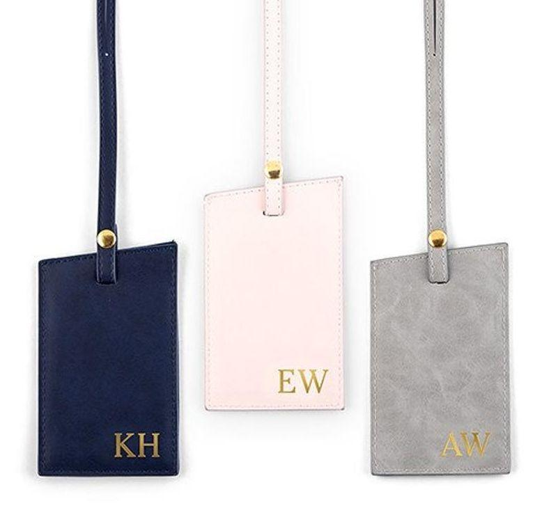 """A luggage tag is practical. The monogram adds a personal touch. And the faux-leather makes it seem fancier than it is, when it's actually vegan. Get it <a href=""""https://www.etsy.com/ca/listing/633165068/faux-leather-monogram-luggage-tag-vegan"""" target=""""_blank"""" rel=""""noopener noreferrer"""">on Etsy</a> for $13.75."""